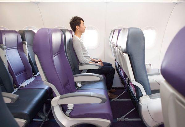 man sitting chair in airplane.jpg